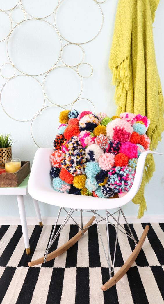 decorate with wool pompoms