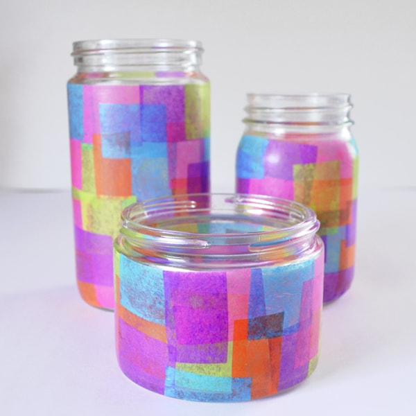 Glass jars lined with coloured tissue paper