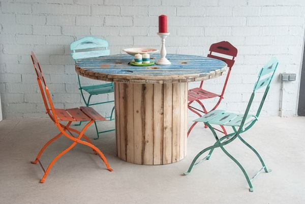 Informal dining room with table made from recycled cable reel