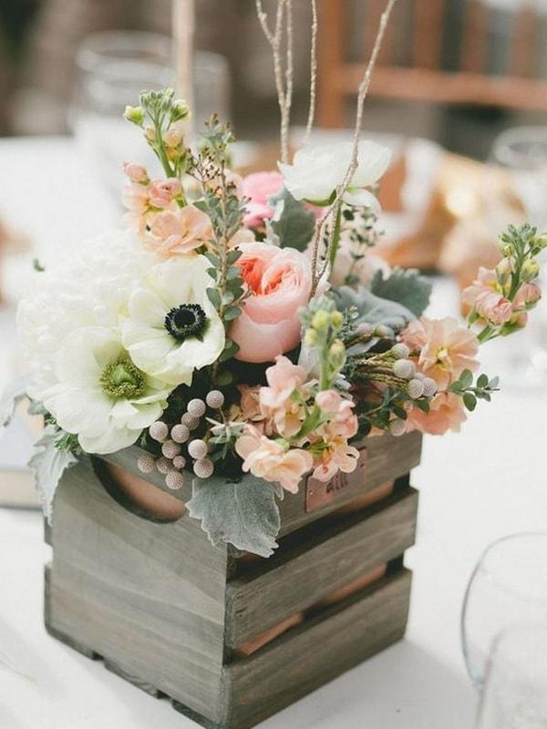 Floral arrangements with wooden boxes