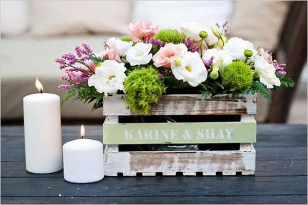 Flower arrangements in wooden boxes