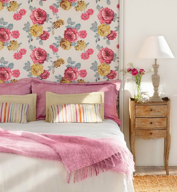 Wallpaper with flowers as bed headboard