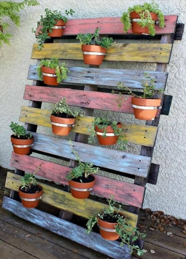Pots hanging from wooden pallets