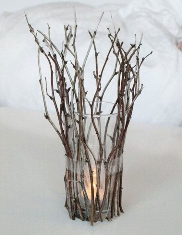 Candleholder with a glass and dry branches