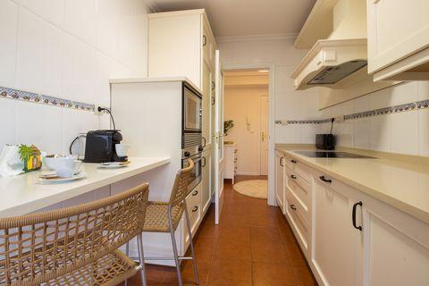 modern white kitchen with breakfast bar
