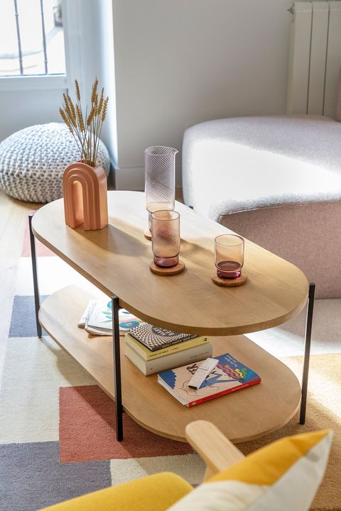 coffee table with open shelf in modern rounded design