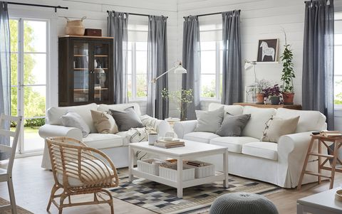 living room with white sofas