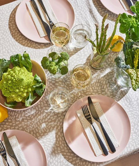 tableware with pink plates and beige tablecloth with dots