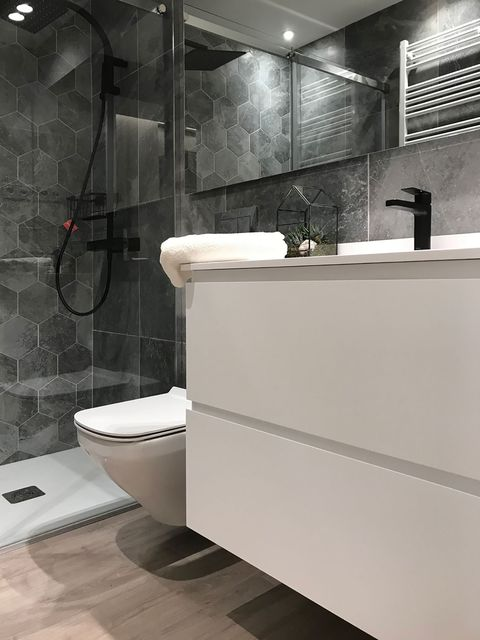 bathroom with shower and floating washbasin unit in white