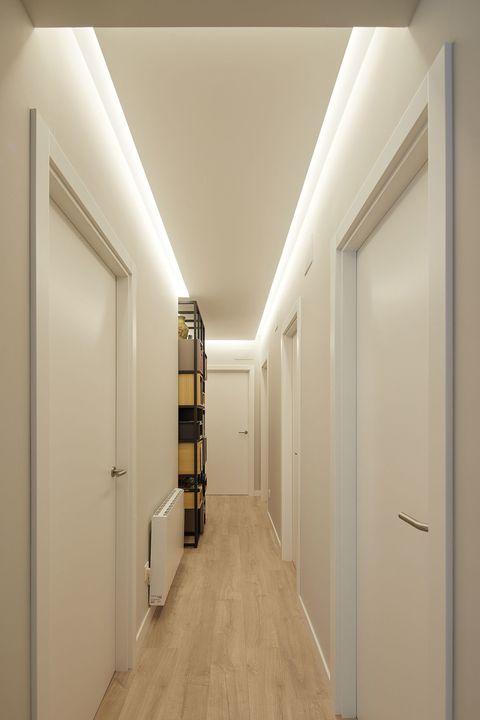 backlit white decorated corridor
