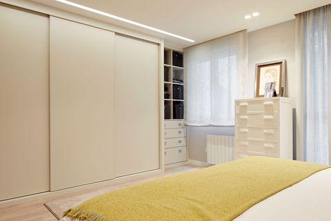 walk-in wardrobe with sliding doors in white
