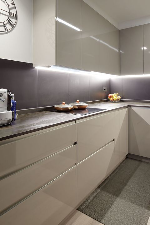 modern design kitchen with lacquered furniture in grey tones