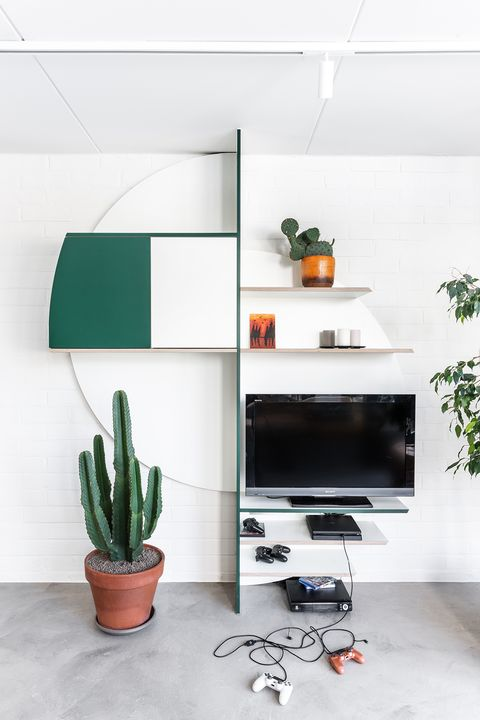 open shelves in white and green with space for the TV