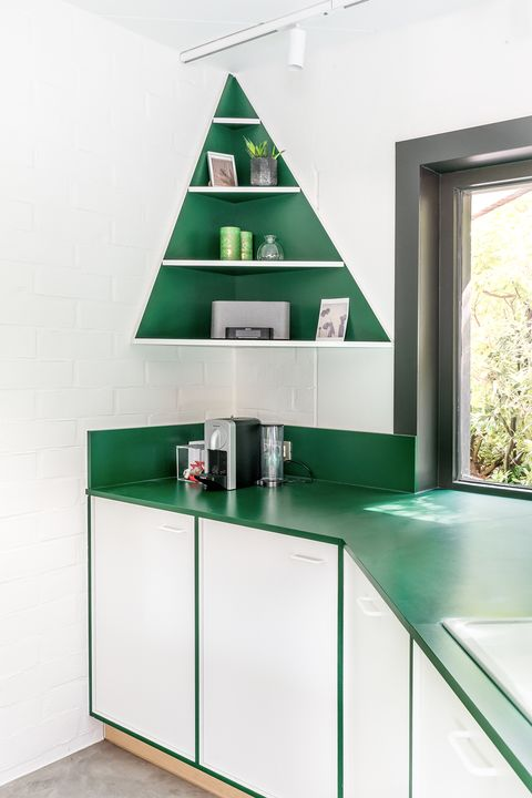 kitchen cabinet and open shelves designed in white and green