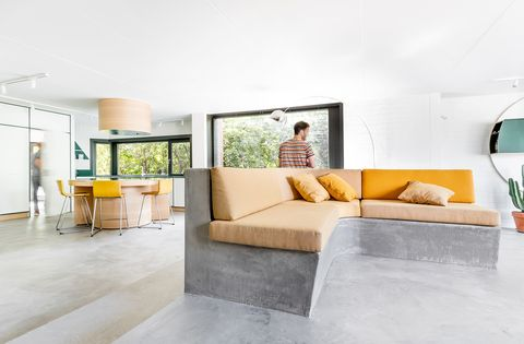 living room open to the kitchen with concrete floor and sofa structure