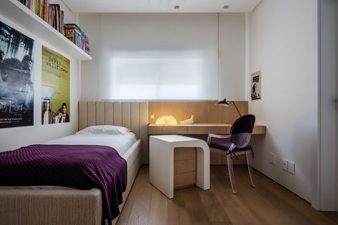 youth room with wooden furniture and neutral tones