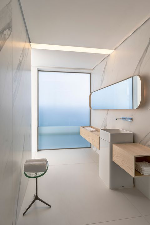minimalist design bathroom with marble effect walls
