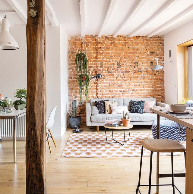 open spaces with exposed brick and wooden beams