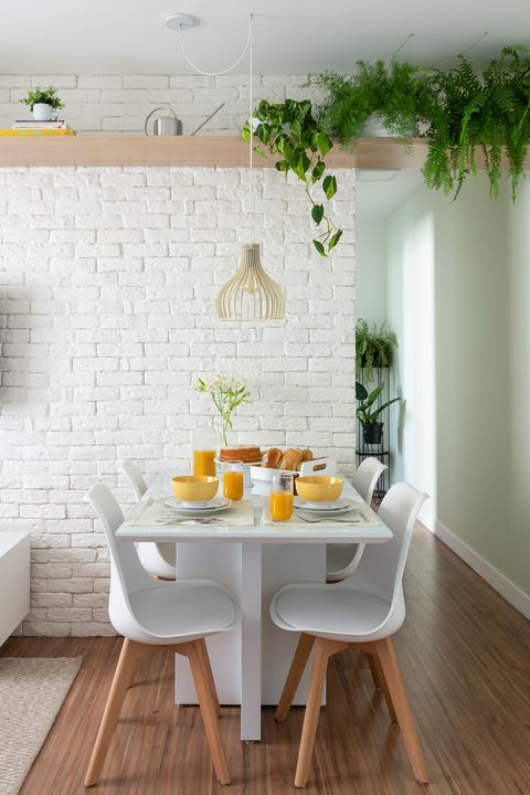 living room with exposed brick wall painted in white