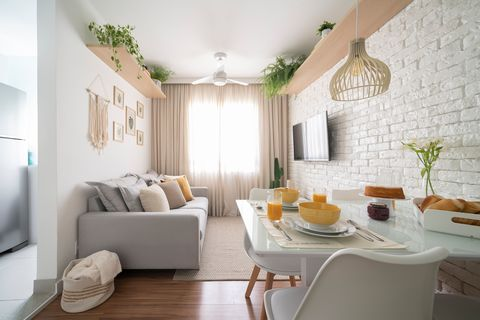 apartment decorated in white tones with macramé details