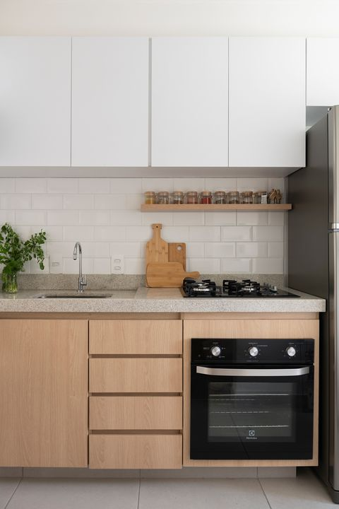 kitchen with wooden cabinets and granite worktop