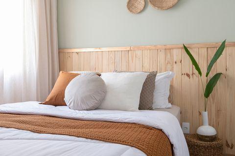 bedroom with wooden headboard