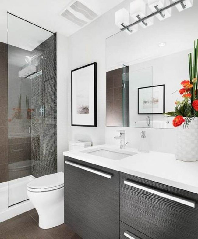 Small bathrooms are expanded with large mirrors and white walls, and see-through shower screens
