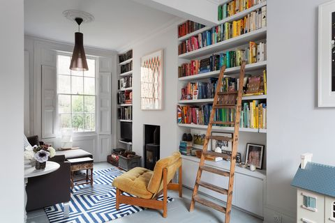 living room with built-in library and open shelves in white