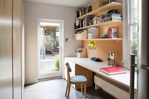 office with desk and open wooden shelves