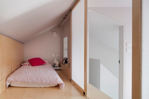 children's bed inside a wooden box