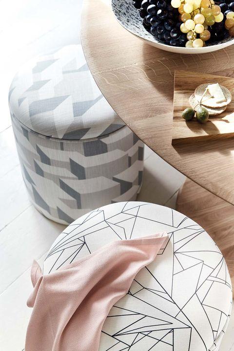 geometrically styled pouf tapestries