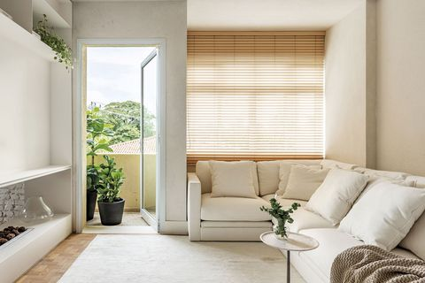 a flat with communicating spaces living room with terrace