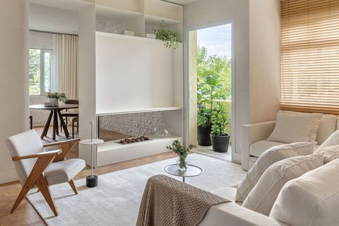 a flat with communicating spaces living room with fireplace