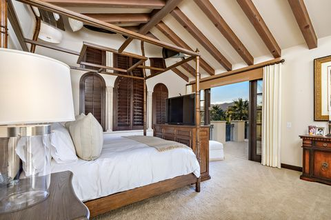 Tuscan-style bedroom with wooden furniture