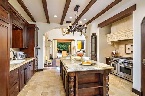 kitchen with central island in classic Tuscan style