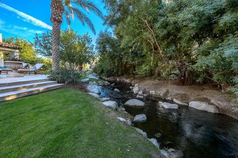 rocky creek surrounding the garden