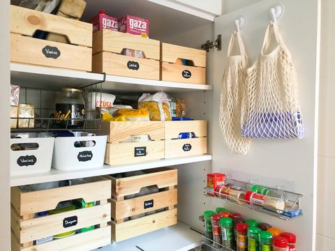 tidy pantry with wooden boxes
