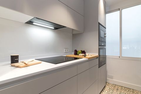 modern kitchen with handleless grey cabinets and ceramic glass