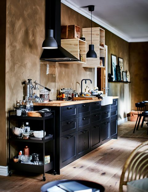 open kitchen decorated in black with wooden worktop from the new ikea 2021 catalogue