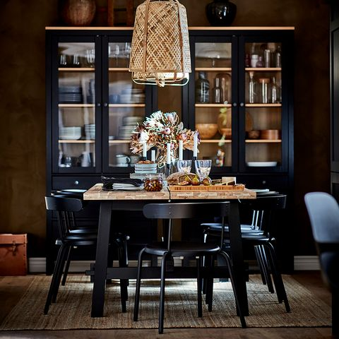 office with black table and wooden top, black display case and bamboo ceiling lamp from the new ikea catalogue 2021