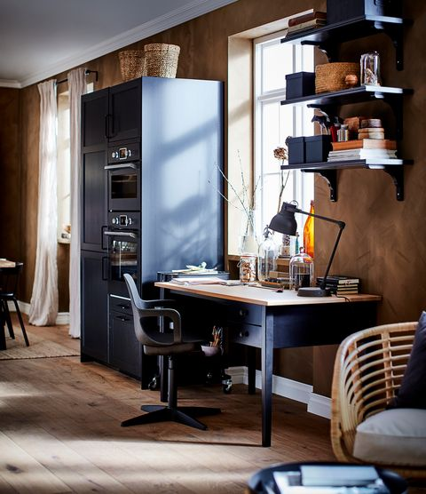 open kitchen with black furniture from the new ikea 2021 catalogue