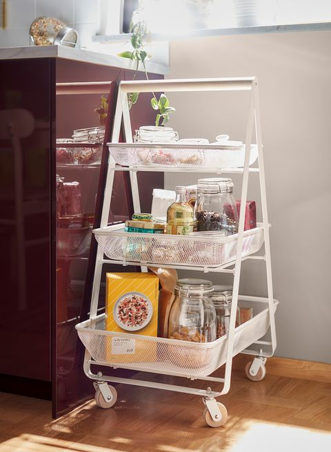 white trolley with wheels and open shelves from the new ikea catalogue 2021