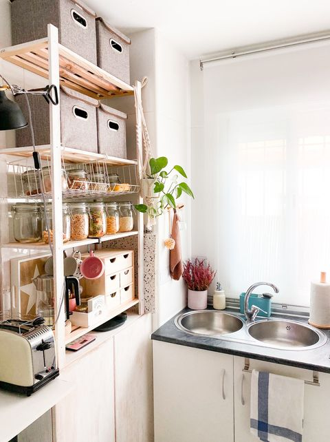 open shelves with boxes and jars in the kitchen