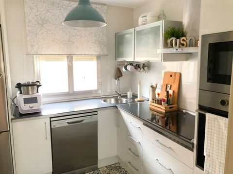 small kitchen designed in white with storage spaces