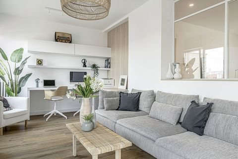 white floor and modern living room with grey sofa and work and study area