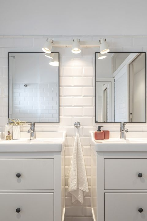 white floor and modern bathroom with two sinks and meter type tiles