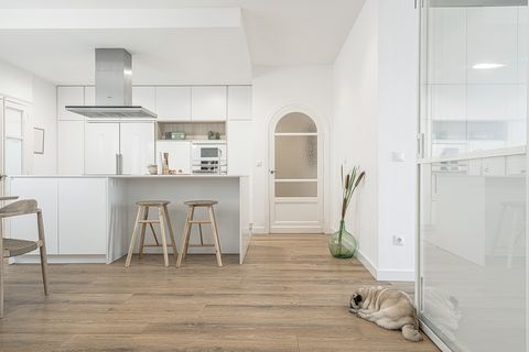 white floor and modern kitchen open to the dining room