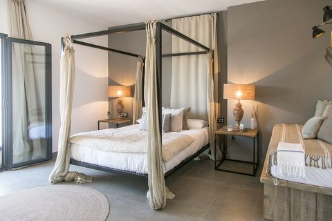 bedroom decorated in earth tones with Mediterranean style