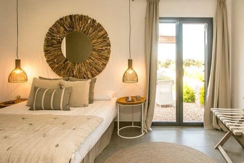 Mediterranean style bedroom decorated in earth tones