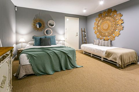 Mediterranean style bedroom with two beds